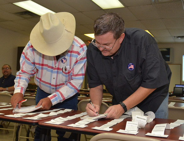 Bo Emo, left, and John Angier check zero sheets Tuesday night as election results come into the Cleveland County Election Board.<br /> Kyle Phillips/The Transcript