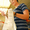 Carrie Martin organizes election paperwork Tuesday evening at the Cleveland County Election Board.<br /> Kyle Phillips/The Transcript