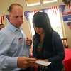 Chad Williams and his wife Amanda go over the lastest poll numbers at Willaims' watch party Tuesday evening.<br /> Kyle Phillips/The Transcript