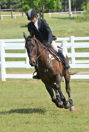 Julie Wolfart and her horse Beaumont take a turn as they prepare to hit another jump during the Training Horse competition Saturday at the competitive horse show at Feather Creek Farms.<br /> Kyle Phillips/The Transcript