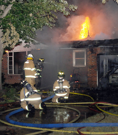 Norman firefighters resonded to this house fire Tuesday, June 26, 2012, in the 1000 block of Leslie Lane.  Jerry Laizure / The Transcript