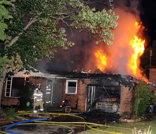 Norman firefighters responded to this house fire Tuesday, June 26, 2012, in the 1000 block of Leslie Lane.  Jerry Laizure / The Transcript