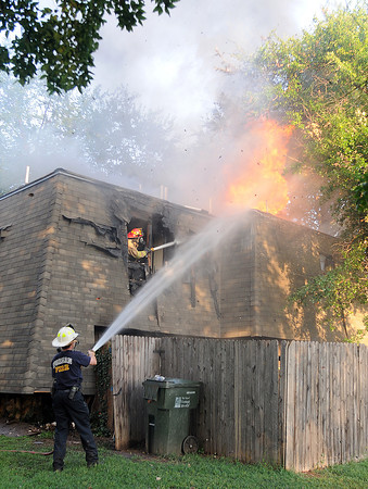Norman firefighters responded to a fire in a duplex in the 600 block of Sinclair Drive, Thursday, June 14, 2012. Four engine companies and one truck company responded to the blaze along with two EMSStat units. Norman police units provided traffic control. The fire marshal said it was too early to comment on the source of the fire. Jerry Laizure / The Transcript