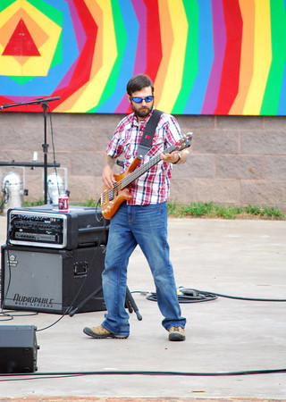 Beau Mansfield Trio bass player Jason Ethridge plays his instrument during a song as the group plays at Groovefest Sunday afternoon at Andrews Park.     The free music and arts festival highlights human rights needs and human rights activist successes.<br /> Kyle Phillips/The Transcript