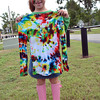 Aby Webb, 6, shows off the tie dye shirt she made at the Groovefest Sunday afternoon at Andrews Park.<br /> Kyle Phillips/The Transcript