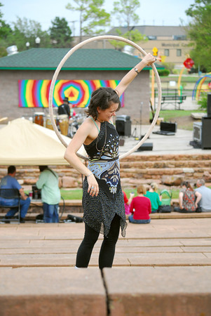 Briana Lyon dances with her hula-hoop Sunday afternoon as the band Broke Brothers plays a song during Groovefest at Andrews Park.<br /> The festival included a variety of vendors and booths, as well as free arts activities for all ages, provided by Scissortail School of Art.<br /> Kyle Phillips/The Transcript