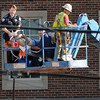 EMSstat and Norman fire medics attend to a construction worker while being lowered to ground levelMonday, June 18, 2012, on an aerial platform. The worker, who later died, fell from the top of the Headington Hall residence hall being built at the corner of Lindsey St. and Jenkins Ave. and landed on a lower roof of the structure. Jerry Laizure / The TranscriptWorker dies in fall from roof of Headington Hall, Monday, June 18, 2012.   Jerry Laizure / The Transcript