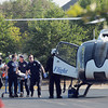 EMSstat, Norman fire and Life Flight personnel load a construction worker onto a Life Flight helicopter ambulance Monday, June 18, 2012. The worker, who later died, fell from the top of the Headington Hall residence hall being built at the corner of Lindsey St. and Jenkins Ave. Jerry Laizure / The TranscriptWorker dies in fall from roof of Headington Hall, Monday, June 18, 2012.   Jerry Laizure / The Transcript