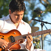Django Reinhardt plays the guitar as the Ivan Peña Ensemble plays a show during Jazz in June at Andrews Park Saturday evening.<br /> Kyle Phillips/The Transcript