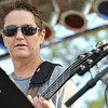 The bass player for Steve Coleman and the OBS All-Stars plays his instrument during the opening night of Jazz in June Thursday night at Brookhaven Village.<br /> Kyle Phillips/The Transcript