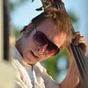 The bass player of the Ivan Peña Ensemble plays his instrument during a songs as the band plays at Jazz in June at Andrews Park Saturday evening.<br /> Kyle Phillips/The Transcript