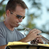 The trumpet player of the Ivan Peña Ensemble plays his instrument during a songs as the band plays at Jazz in June at Andrews Park Saturday evening.<br /> Kyle Phillips/The Transcript