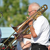 A member of the New Horizons Jazz Band plays her part during the band's performance Saturday Jazz in June at Andrews Park.<br /> Kyle Phillips/The Transcript