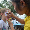 Eden Green, 6, gets her face painted at the Wild Praire Family Park during the Norman Music Festival Saturday afternoon.<br /> Transcript Photo by kyle Phillips