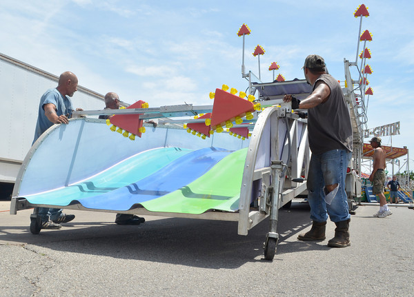 """Carnival workers set up the """"Fun Slide"""" Wednesday aftrnoon as they get the Lions Club Carnival ready for its opening day.The carnival will run from 6 p.m. Thursday to 6 p.m. Sunday<br /> Transcript Photo by Kyle phillips"""
