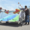 "Carnival workers set up the ""Fun Slide"" Wednesday aftrnoon as they get the Lions Club Carnival ready for its opening day.The carnival will run from 6 p.m. Thursday to 6 p.m. Sunday<br /> Transcript Photo by Kyle phillips"