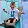 "Brayden Goodwin, 4, slides down the ""Fun Slide"" Saturday afternoon at the Lions Club Carnival.  The carnival will be in the parking lot next to Coach's unitl 6 p.m. today.<br /> Transcript Photo by Kyle Phillips"
