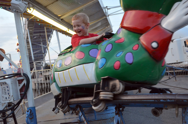 Jacob Woods, 6, rides the Go-Gator Thursday evening at the Lions Club Carnival.  The carnival, near Coach's on Main Street will continue all weekend and will end at 6p.m. Sunday.<br /> Transcript Photo by Kyle Phillips