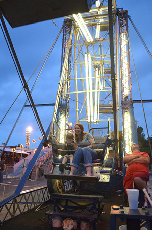 Kristie Anderson and her son Carter Wilson, 4, ride the Farris Wheel Thursday evening at the Lions Club Carnival.<br /> Transcript Photo by Kyle Phillips