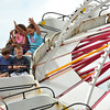 """Children raise there arms in delight as they ride the """"Tilt-o-Whirl"""" Saturday afternoon at the Lions Club carnival.<br /> Transcript Photo by Kyle Phillips"""