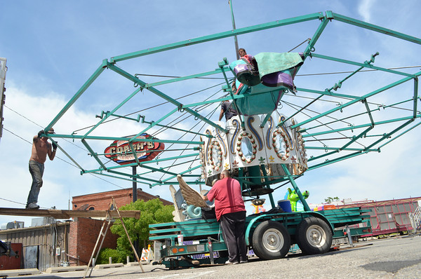 Carnival workers set up a ride  Wednesday afternoon as workers get the Lions Club Carnival near Coach's on Main Street ready for today's opening. The carnival will run from 6 p.m. Thursday to 6 p.m. Sunday <br /> Transcript Photo by Kyle Phillipsready to oper