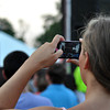 A fan captures a photograph during the Lower 40 concert Wednesday night. Julie Bragg/ The Transcript
