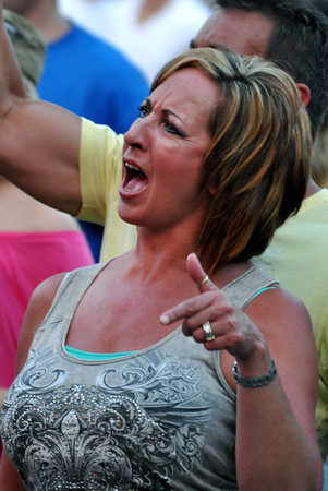 Kerri Betterton sings along with Lower 40 Wednesday night at the free summer concert at the University of Oklahoma. Julie Bragg/ The Transcript
