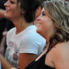 Tess Chronister and Kati Word enjoy the free summer concert Wednesday night at the University of Oklahoma. Julie Bragg/ The Transcript
