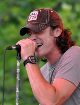 "Lower 40's lead singer Kyle Earhart performs during a free concert on the east Union lawn at the University of Oklahoma Wednesday night. Lower 40 was named The Country Music Association ""Who Knew to Watch 2012."" Julie Bragg/ The Transcript"