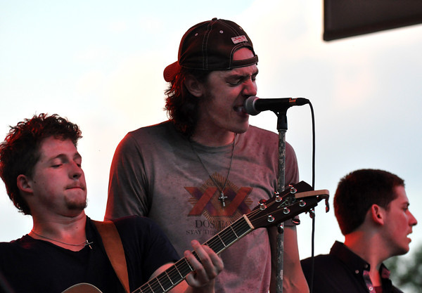 Zach Felts, Kyle Earhart and Mikey Hines, members of Lower 40 perform a free summer concert at University of Oklahoma. The concert was sponsored by the OU Summer Session. Julie Bragg/ The Transcript