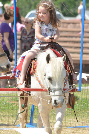 Ellen Sellers, 2, enjoys a pony ride at the May Fair Saturday afternoon at Andrews Park.<br /> Kyle Phillips/The Transcript