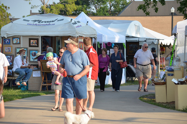Crowds thin out at the May Fair Saturday afternoon at Andrews Park as vendors start packing up their booths to end the festivities.<br /> Kyle Phillips/The Transcript