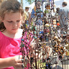 Paige Dalton, 9, looks at jewelry at a booth at the May Fair Saturday afternoon at Andrews Park.<br /> Kyle Phillips/The Transcript