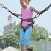 Lizzie Glass, 7, jumps on the bungee trampoline at the May Fair Saturday afternoon at Andrews Park.<br /> Kyle Phillips/The Transcript