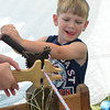 Jacob Cheatwood turns a wheel to make a rope at the May Fair Saturday afternoon at Andrews Park.<br /> Kyle Phillips/The Transcript