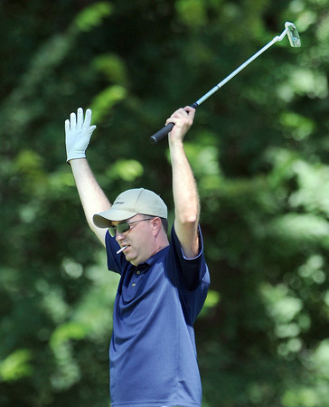 John Woods celebrates his putt Monday, July 16, 2012, during the Norman Meals on wheels charity golf tournament at the Trails. Jerry Laizure / The Transcript