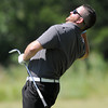 Joey Vaughn reacts to his chip shot  Monday, July 16, 2012, during the Norman Meals on wheels charity golf tournament at the Trails. Jerry Laizure / The Transcript