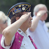 Estelene Schulenberg salutes during the playing of Taps at the American Legion Post 88 Memorial Day service, Monday, May 28, 2012. Jerry Laizure/The Transcript