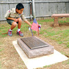 "Walker Pitchlynn picks up a flag from a grave at Warren Cemetery Sunday afternoon that Boy Scouts from Troop 217 placed on graves for Memorial Day.  To see more photos of Memorial Day celebrations around Norman visit <a href=""http://photos.normantranscript.com"">http://photos.normantranscript.com</a>.<br /> Kyle Phillips/The Transcript"