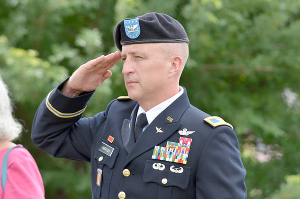 Col Jon Harrison sulutes the American flag at the American Legion's Memorial Day service at Warren Cemetery Sunday afternoon.<br /> Kyle Phillips/The Transcript