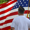 Tyrone Richard II holds the American flag during the American Legion Memorial Day services Sunday afternoon at Warren Cemetery.<br /> Kyle Phillips/The Transcript