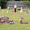 Louise Powell walks around  Warren Cemetery as she visits her family's grave site Sunday afternoon before the American Legion Memorial Day service at the cemetery.<br /> Kyle Phillips/The Transcript