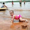Eleven-month-old Chelsea Hill joined dozens of others this Memorial Day, Monday, May 28, 2012, at Zoom Beach at Lake Thunderbird.  Jerry Laizure/The Transcript