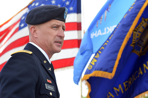 Col Jon Harrison speaks about the importance of decorations at the American Legion's Memorial Day service at Warren Cemetery Sunday afternoon.<br /> Kyle Phillips/The Transcript
