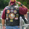 A Patriot Guard Rider salutes the flag during Memorial Day services at Sunset Cemetery, Monday, May 28, 2012. Jerry Laizure/The Transcript