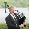 Joel McClung plays Taps on the bagpipes at Memorial Day services at SunSet Cemetery, Monday, May 28, 2012. Jerry Laizure/The Transcript