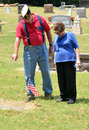 Jerry Duty, left, and Helen Patrick look at grave at Warren Cemetery before the start of the American Legion's Memorial Day service Sunday afternoon.<br /> Kyle Phillips/The Transcript
