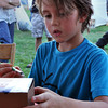 Liam Hosty, 8, son of Kellie Hosty, paints a cube to be shown at the Midsummers Night's Fair Friday night. Children can create/paint crafts that can be judge for an award. Julie Bragg/ The Transcript