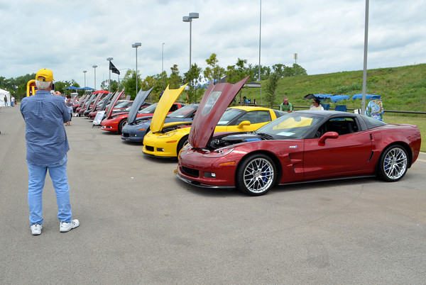 Jack Rea takes a picture of a row of Corvettes at the Non Club Club of Oklahoma's All Corvette Show at Marc Heitz Chevrolet Saturday afternoon.<br /> A variety of Corvettes ranging from early models to current versions  were on display at the event, showing the how far the car has come in its design<br /> Kyle Phillips/The Transcript