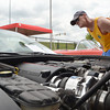 Don Harrison looks over the engine of a 2000 Chevy Corvette at the Non Club Club of Oklahoma's All Corvette Show at Marc Heitz Chevrolet Saturday afternoon.<br /> Kyle Phillips/The Transcript